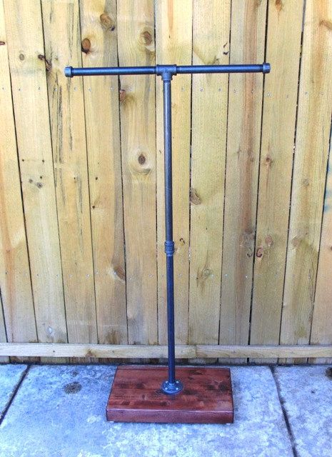 This is our T stand clothing rack. This rack is made with reclaimed wood and the best pipe and fittings available. ** This rack is available