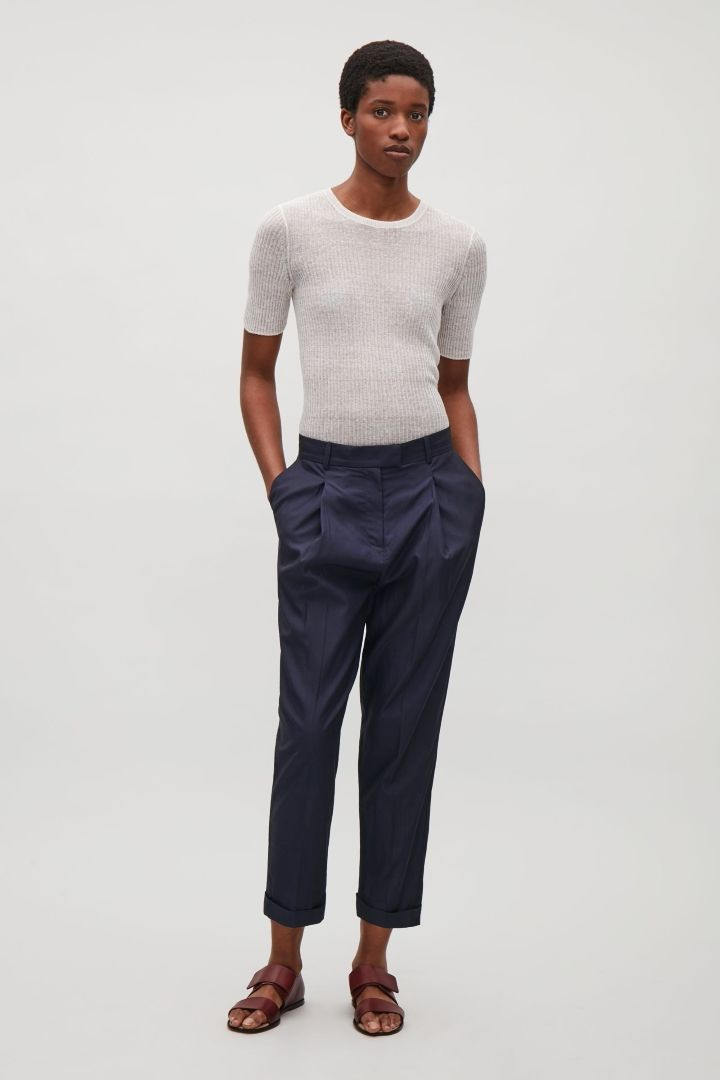 COS image 1 of Relaxed pleated trousers in Indigo