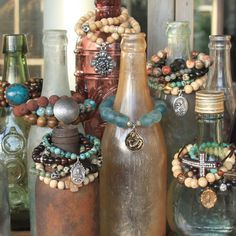 old bottles for bracelets (For Giving Works artisan jewelry)  I do this, with a different bottle for different color families. It makes it so much easier to find what might look best with an outfit.
