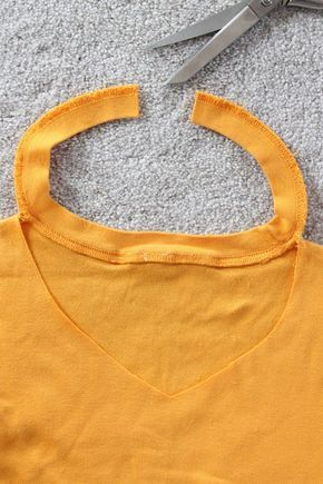 Change your crew neck t-shirts into a more flattering v-neck in a few simple steps without even adding any fabric.