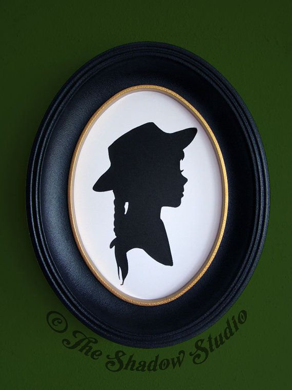 This is a hand-cut paper silhouette of young Anne Shirley. It comes mounted on a 5x7 piece of sturdy white cardstock, ready to frame. These
