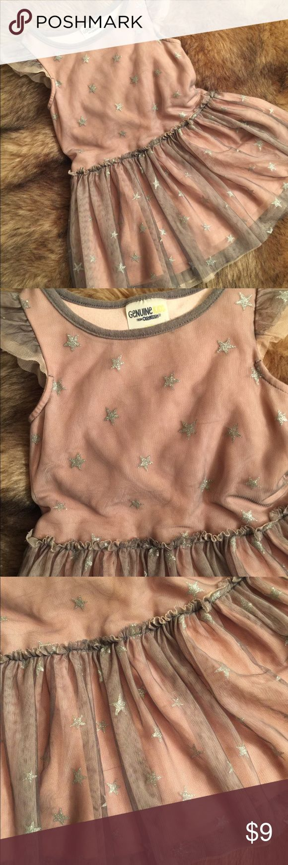 GENUINE by Oshkosh Girl's Pink and Silver Dress This adorable dress for your toddler is super cute and so much fun! She will love it!  Has underlining of soft pink Cotten with overlay of fine mesh netting with glitter stars. It is a pullover and it is in great condition. Tiny flaws as pointed out in pic.. a few threads pulled but it honestly is only noticeable held up to eye. It is so cute.. looks and acts like Party Dress but good anytime for fun play! Priced accordingly. GENUINE by OSH…