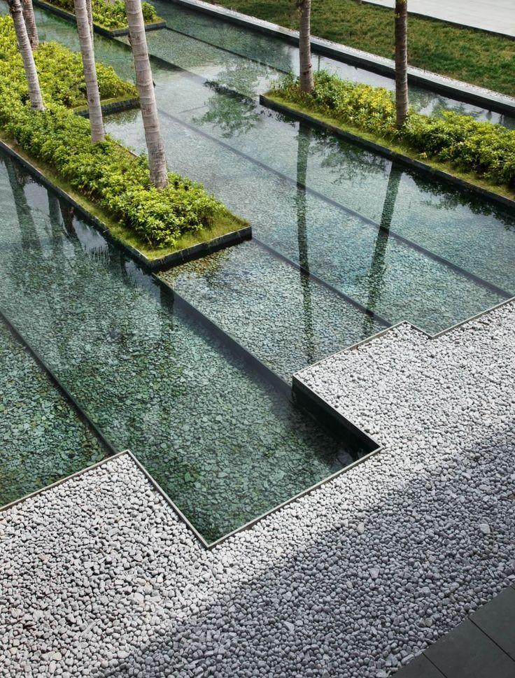 stone, water, greenery, tree, intersecting planes  woha architects / intercontinental resort sanya, hainan island