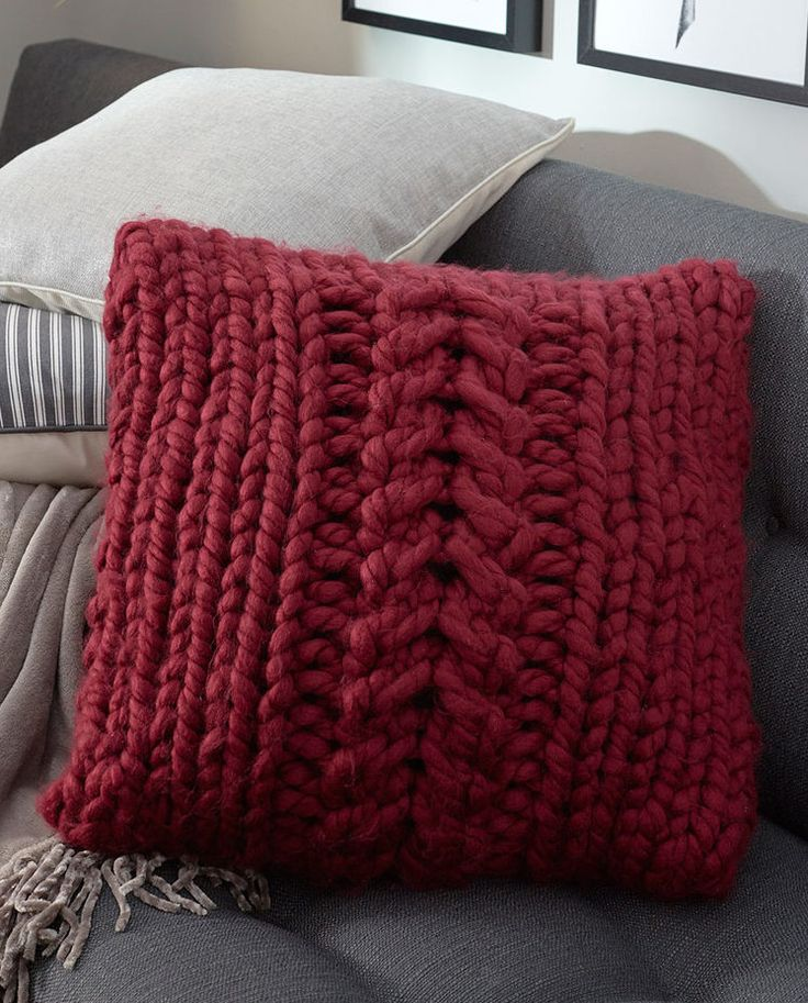 "Free Knitting Pattern for Easy Oversized-Cable Pillow - Cushion cover features a large central cable in front and button fastening in back. Finished pillow cover measures 20"" x 20"" (51 x 51 cm). Quick knit in jumbo yarn. Designed by Stacey Gerbman for Red Heart."