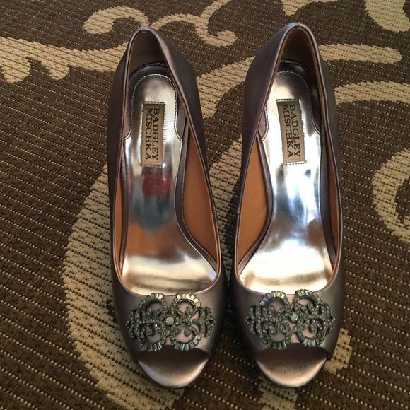 Badgley Mischka Silver Evening Shoes size 8.5 Silver evening shoes size 8.5. Beautiful embellishment adorning this peep toe pump.  Genuine leather upper and leather sole. Badgley Mischka Shoes Heels