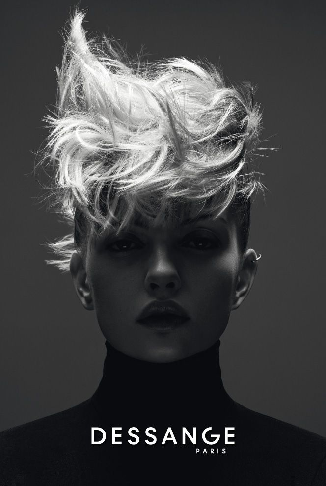 """The """"Coiffé-Décoiffé"""" updo: A hairstyle with a chic punk spirit and double contrast: the dark sides of the head are slicked back and held down with flat clips to reinforce the striking presence of hair on top of the head, with its ultra-luminous and controlled messy look. #DESSANGE #Collection #FallWinter #LightOfShadows"""