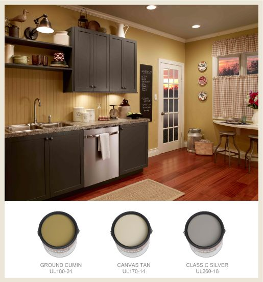 Rich Gold Walls Contrast With Dark Gray Cabinets For A Trendy Combo In This Casual Kitchen