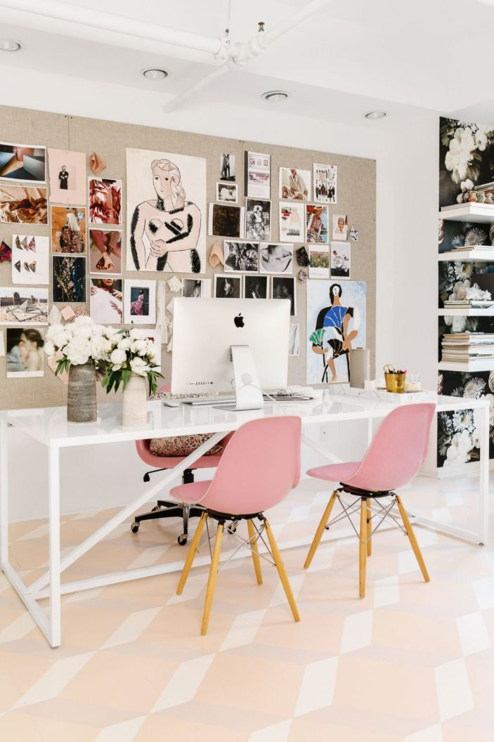 """A large <a href=""""http://www.bludot.com/strut-table-medium.html"""" target=""""_blank"""">BluDot dining table</a> actually serves as the workstation, flanked by fiberglass shell chairs. The inspiration board is layered by images and paintings by Rebecca's husband, artist Wayne Pate."""