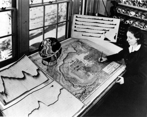 Marie Tharp, sitting at her desk at Columbia's Lamont Geological Observatory, 1956. Copyright: Lamont Archives, Lamont-Doherty Earth Observatory.