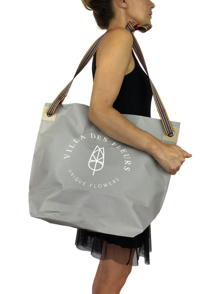 Reusable shopping bag with shoulder strap.