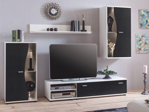 Obývacia stena, ktorá vás zaujme eleganciou a neobyčajným dizajnom dvierok vitrín. Skladá sa z vitríny, ktorá má zaujímavé zaoblené dvierka, TV stolíka, vitríny na stenu a širokej police. Farebné prevedenie obývacej steny je biela v kombinácii s čiernou farbou.