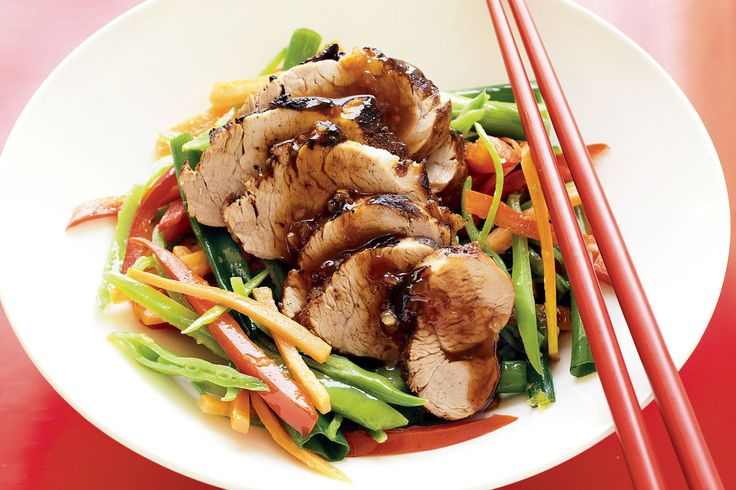 Carve succulent slices of roast pork smothered in a rich Chinese-style marinade.