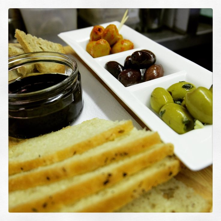 Pane e Olivia  Our new bread and olive platter. A trio of olives from the fantastic Oliver's olives based in Newlyn, served with Mike's homemade bread, Sicilian First Press Extra Virgin Olive Oil and Antoninis balsamic reduction.