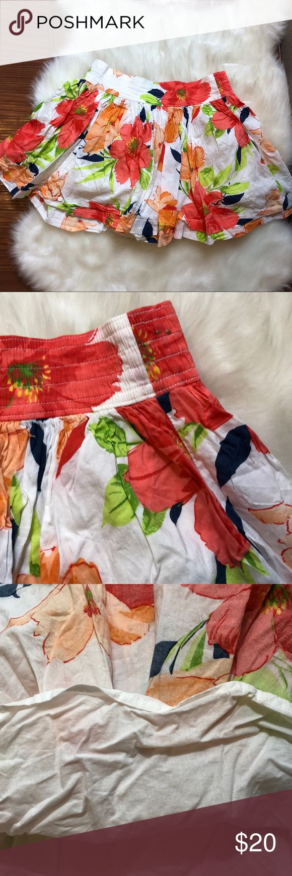 """HOLLISTER White Floral Mini Skirt Light and breezy fully lined white mini skirt with orange and red flower floral print by Hollister.  Materials: cotton viscose Length 13""""  Waist (across) 13""""  Excellent used condition. No flaws! Hollister Skirts Mini"""