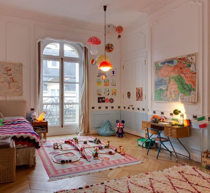 Beautiful childrens room with lots of colour and play space.