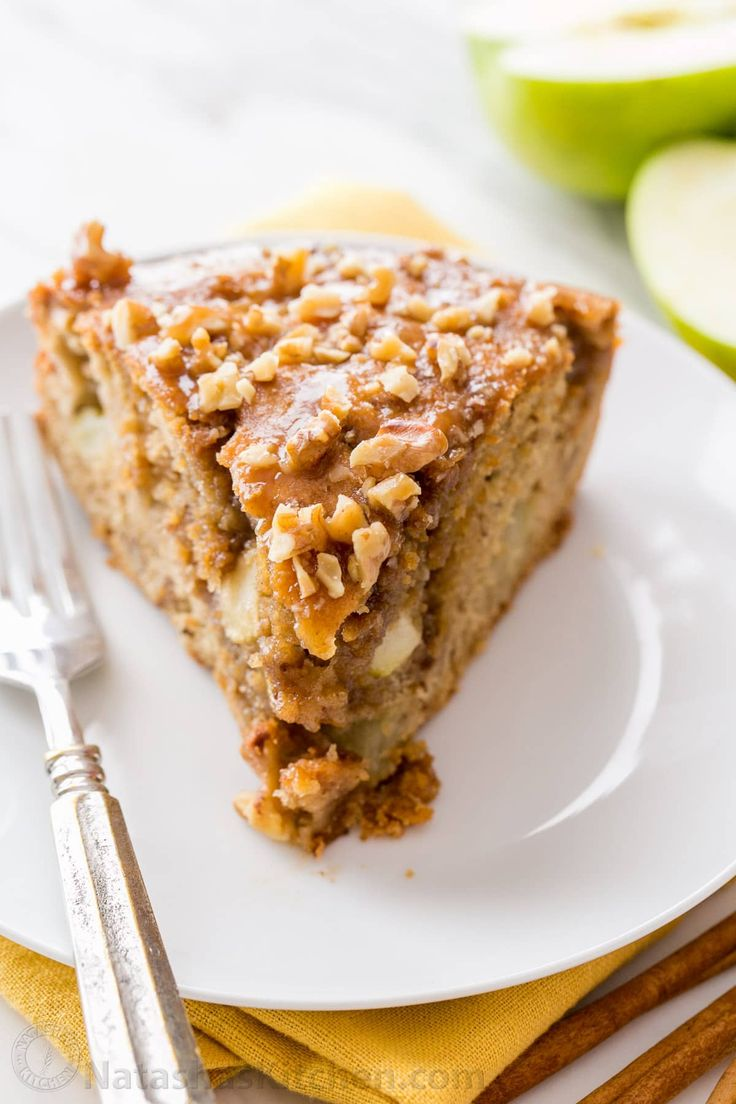 Apple coffee cake (classic apple dapple cake) is loaded with apple and walnuts. The caramel sauce creates a moist, buttery center. Easy apple coffee cake! | natashaskitchen.com