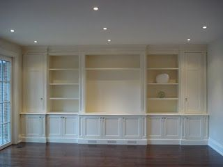 wall unit, build me! (opposite wall of hand-built fireplace) And wall of windows to the left-looking at this picture