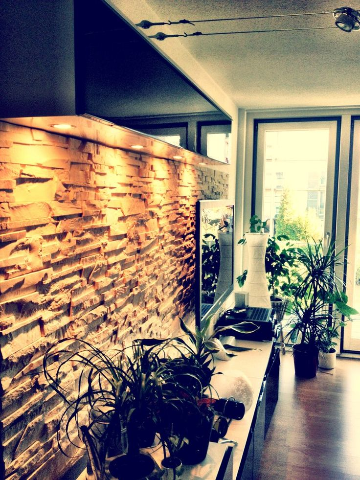 A BESTA media unit with stone wall panel. Love!