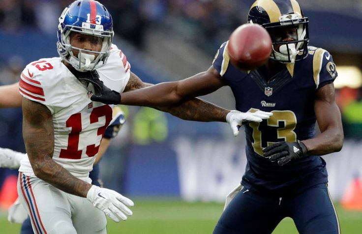 Giants vs. Rams in London:     October 23, 2016  -   17-10, Giants  -  New York Giants wide receiver Odell Beckham (13) and Los Angeles Rams wide receiver Mike Thomas (13) fight for the ball during an NFL game between the New York Giants and the Los Angeles Rams at Twickenham Stadium in London, Sunday, Oct. 23, 2016.