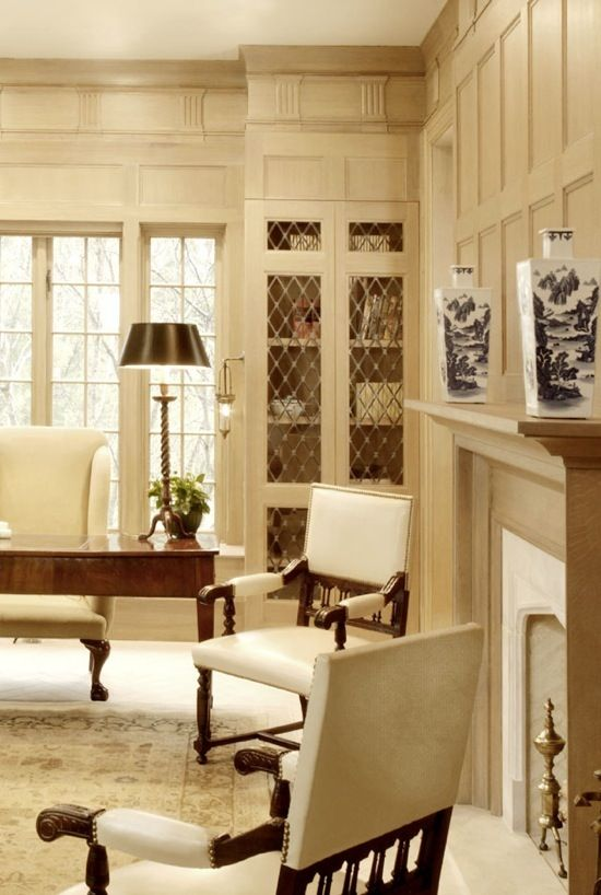 Gorgeous office with detailed walls and bookshelves. Color palette + arm chairs, mantel - inspiration for library/office.