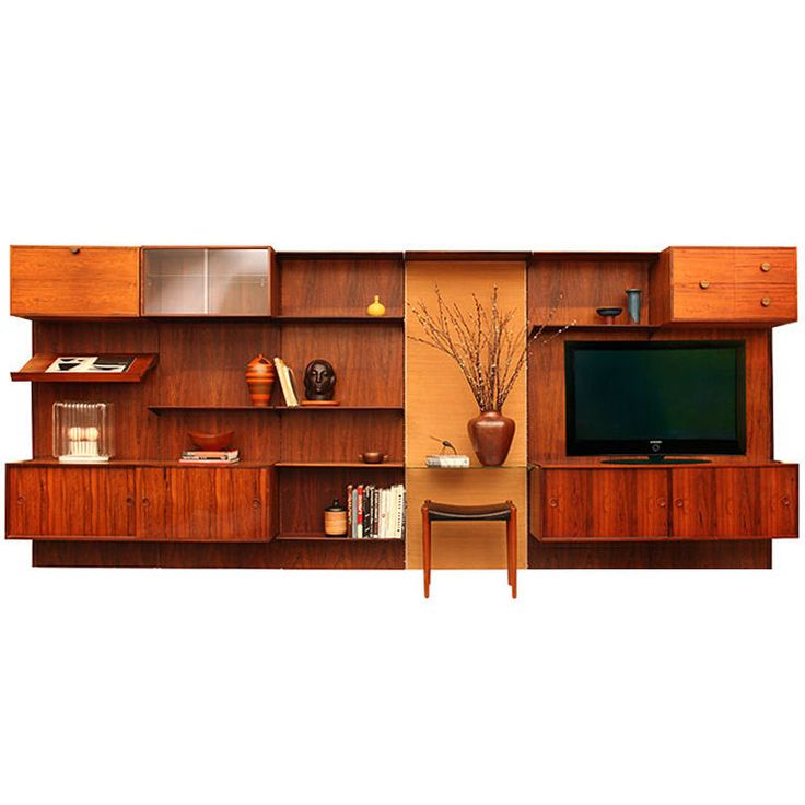 the wall unit by finn juhl denmark a rosewood wall unit comprised of six panels each wide one reed covered and five rosewood panels