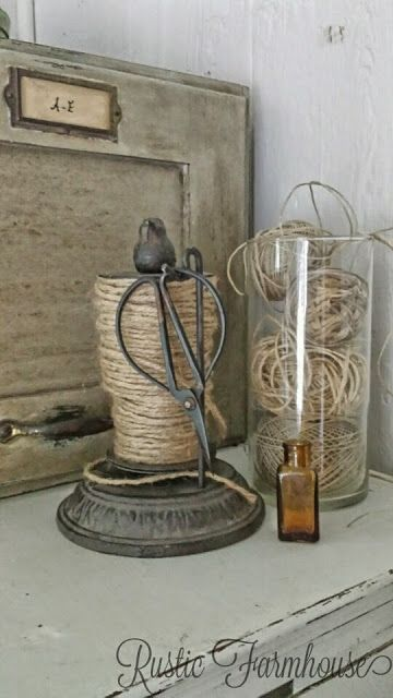 Jar of twine with twine holder with collection of bonsai scissors.