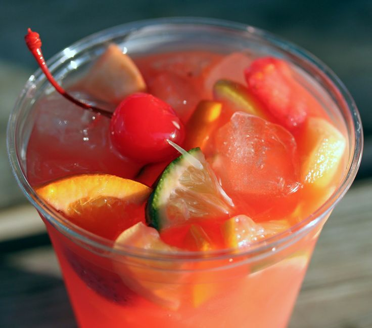 Dana's Texas Fever Water: Makes 5 gallons ~ vodka, rum, orange juice, grenadine, sugar, assorted fruits (whatever fruit floats your boat), maraschino cherries & ice