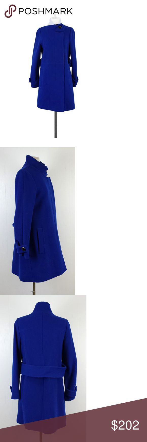 """Trina Turk- Cobalt Blue Wool Coat Sz 8 This comfy wool coat will keep you warm while still giving you a sleek look. Rich cobalt blue color gives you a nice pop, pair it with a LBD and pumps for a classic and effortless outfit! Size 8 Body 80% Merino Wool 20% Nylon Lining 100% Polyester Zip & buttons on front Side pockets Shoulder to Hem 35"""" Trina Turk embodies a pretty, flirty and fun style. Her collections are perfect for the office or a weekend getaway. This particular designer likes to…"""
