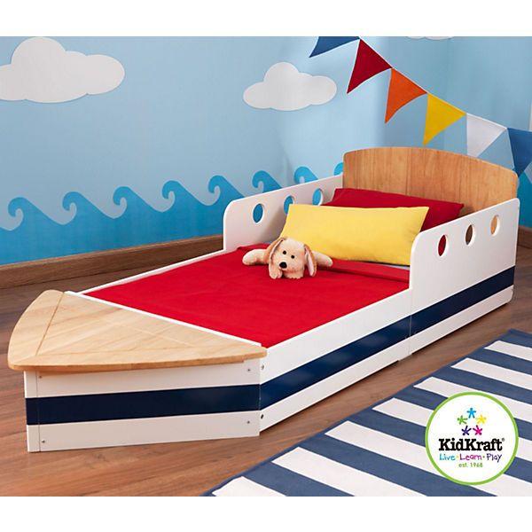 Da werden kleine Matrosen große Augen machen. Das wunderschöne Kinderbett von KidKraft ist einem Boot nachempfunden und sorgt dafür, dass Ihr Liebling gemütlich ins Land der Träume segeln kann. Die Seitenteile am Kopfende sehen aus wie eine Reling und schützen Ihr Kind, sodass es nachts nicht aus dem Bett rollen kann. Um auch den Kleinsten einen einfachen Ein- und Ausstieg zu ermöglichen, ist das Bett extra niedrig gehalten. Besonders praktisch ist der Stauraum am Fußende, der Platz für…
