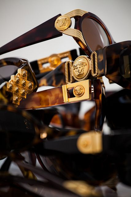 This is how SALE at Sammy  Nino's looks like, it's golden! On this stack: vintage Gianni Versace sunglasses