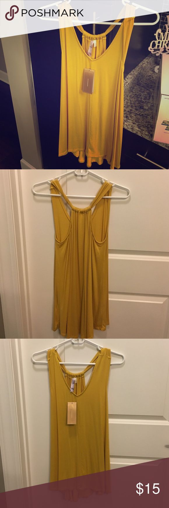 Mustard color long tank top from Francesca's Perfect with leggings or as a cover up! Never worn and is perfect condition. Was received as a gift but was too big for me. The size is small and would look great with a bralette! Francesca's Collections Tops Tank Tops