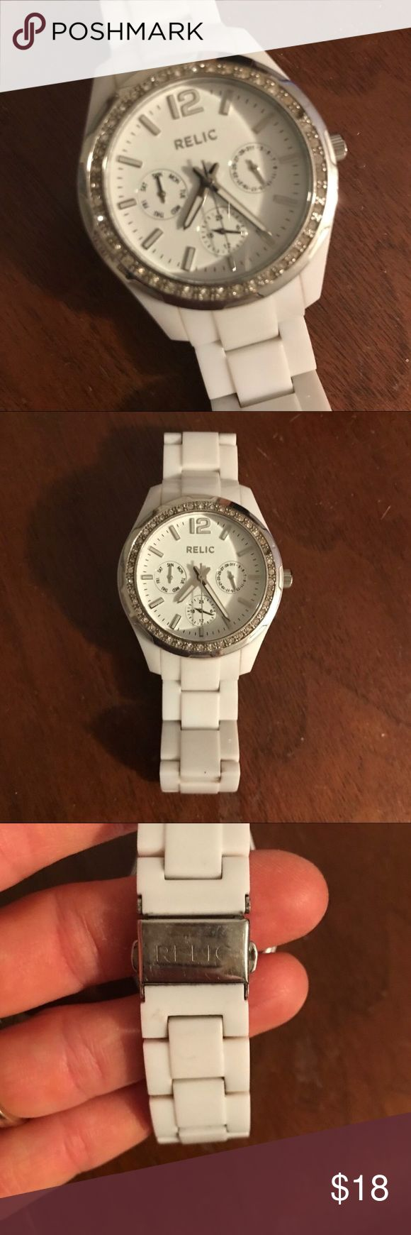 White Relic watch White Relic watch with silver detail and rhinestone details around the dial. Needs new battery. Relic Accessories Watches