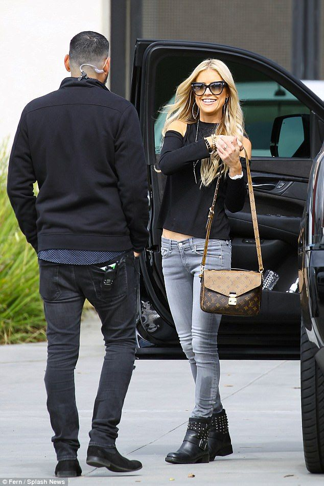Flipping happy: Christina El Moussa lit up Orange County with her smile on Monday as she met up with a male friend