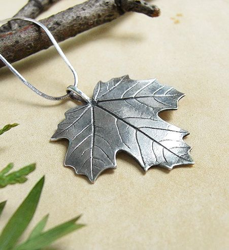 Canadian maple leaf - sterling silver pendant by Anastasia Sobkevich.