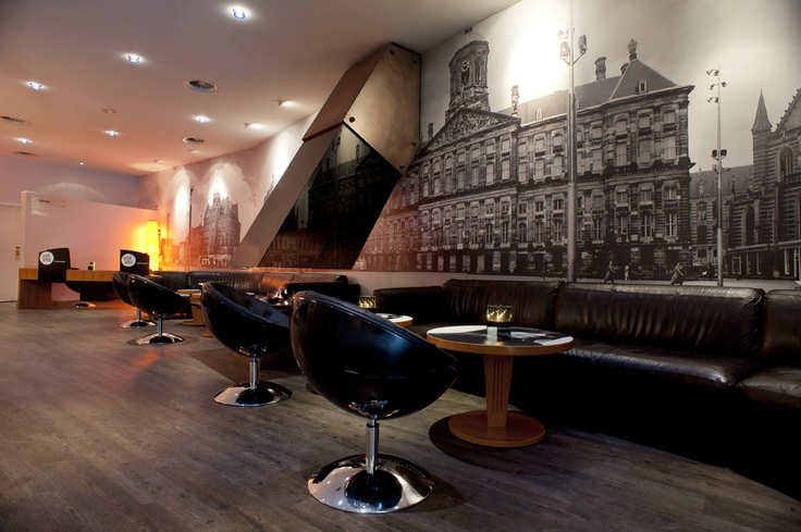 Lounge with fireplace at Inntel Hotels Amsterdam Centre