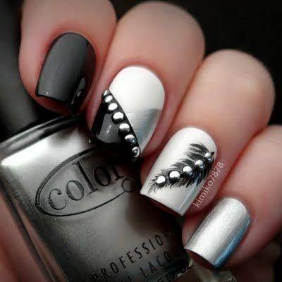 negro, blanco y plata.... decoración con pluma negra y pedrería plata...