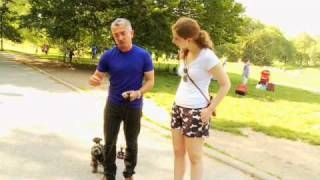 Dog Whisperer: Training a dog to walk on the right side. video 2min31sec.