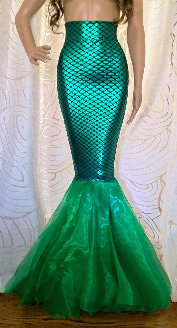 Handmade green mermaid tail skirt. The skirt is made from sparkle spandex fabric that reflects metallic green sparkle scales. The fabric stretches so it contours the body beautifully and flows whimsically when you walk. Its stunning in person.  Available sizes: XSmall: Skirt size 0-2 Small: Skirt size 2-4 Medium: Skirt size 6-8 Large: Skirt size 10-12 XL: Skirt size 14  **Size Chart (in inches)** XSmall... Waist 23-24 Hips 32-33 Size S... Waist: 25-27 Hips: 34-37 Size M... Waist: 28-30…