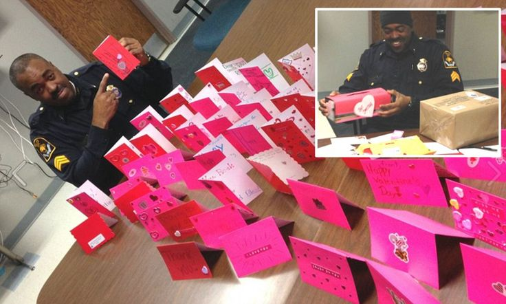 Police who never got Valentine's Day cards as a kid swamped with love-Police sergeant is deluged with Valentine's Day cards after telling captain he never received one as a child.      Omaha Police Sgt. Brian Smith never received a Valentine's Day card.     After his captain posted this on Facebook they began pouring in.     Sgt. Smith has been sent hundreds of cards, gifts and candy boxes.<3