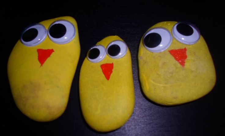 Stones painted as chickens.