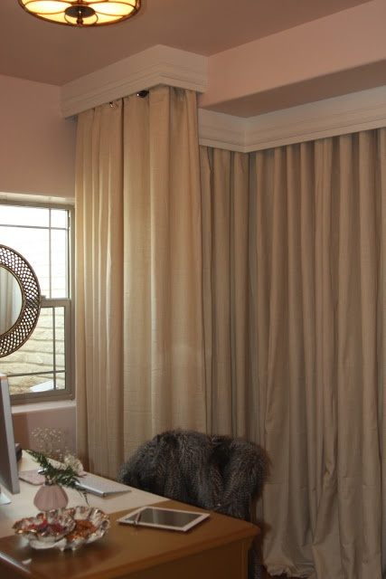 Hide water heater but use ikea straight panels and ceiling moulding. Wire shelving behind curtains.