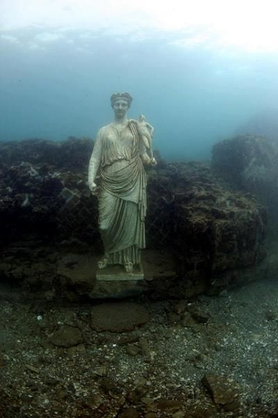 The Sunken City of Baia, Italy. It was a Roman seaside resort on the Bay of Naples.Baiae was even more popular than Pompeii, Herculaneum, and Capri. Baiae was sacked by Muslim raiders in the 8th century AD and was deserted because of malaria by 1500. Because of coastal subsidence most of Baiae is now under water in the Bay of Naples, largely due to local volcanic activity.