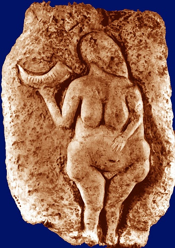 (artist unknown, Woman holding a bison horn, painted limestone, ca 25,000-20,000 BC, Paleolithic art). One of the earliest examples of Naturalistic representations of humans. Most parts of the female figure are in the correct place and proportion. However, there is an exaggeration of the breasts, abdomen, and hips. This relief sculpture proves the ability of these early artists to represent humans more naturalistically, when the subject matter required it. (Kleiner 18)(Fingesten 307)