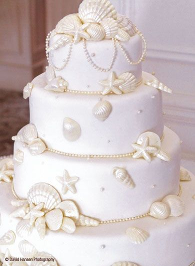 Beach House Living: Beach and Bridal™ Shell bouquets centerpieces and cakes for the beach bride. THIS IS GORGEOUS!
