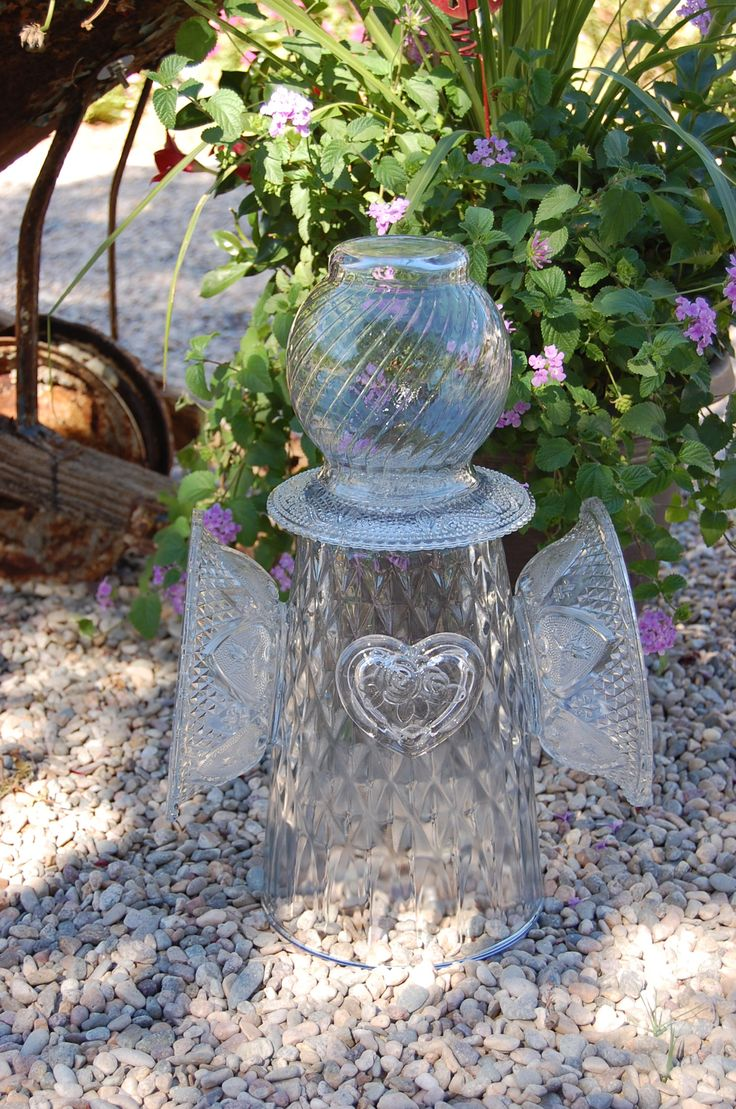 Glass angel yard art made from two vases, a saucer and two bowls