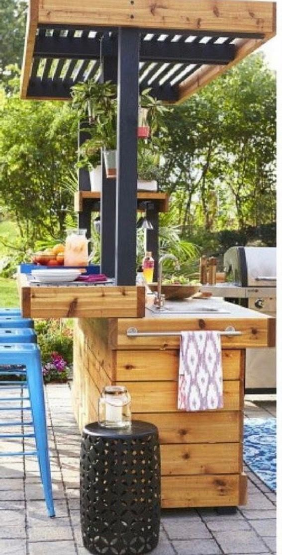 Extend bar through railing onto deck area near kitchen