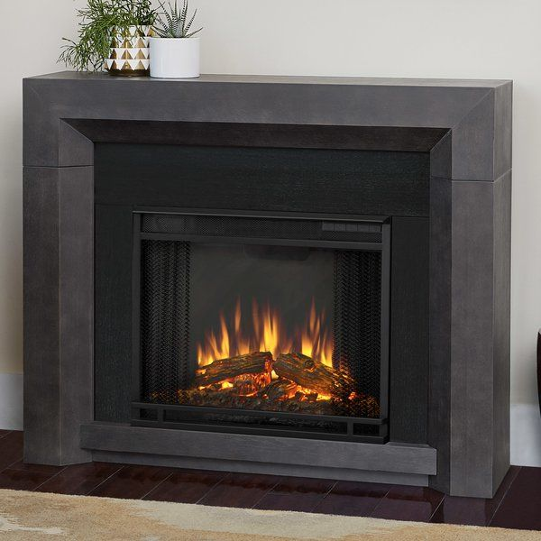Warm up your space with the sleek, modern style of the Hughes electric fireplace. This contemporary piece has a beveled face with a black finish and easily plugs into any standard outlet. The VividFlame electric firebox features include remote control, programmable thermostat, timer function, brightness settings and ultra bright VividFlame LED technology.