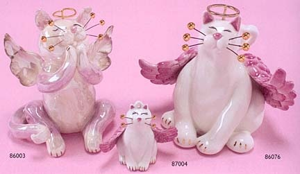 whimsiclay cats by willitts....ahem, aha! Made you smile :-).  Cute family
