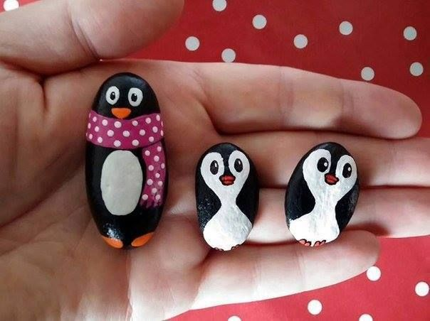 family of penguins made with painted stones  - rocks art