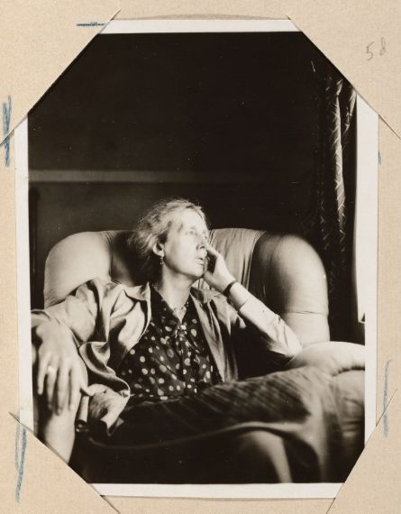 Virginia Woolf sits in an armchair indoors, Monk's House (Sussex, England), 1931 August